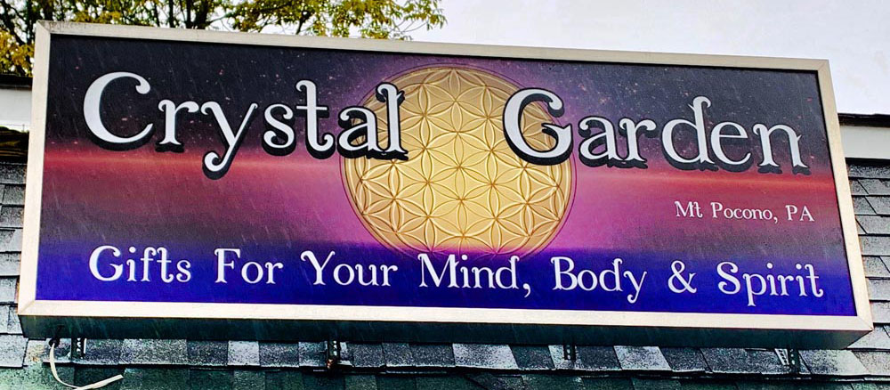 Crystal Garden metaphysical store roof sign